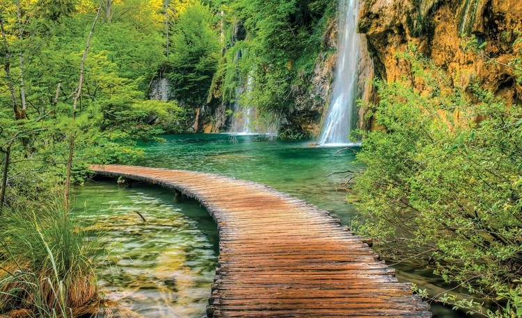 Posters Fototapeta Path Sea Mountains Waterfall Forest 104x70.5 cm - 130g/m2 Vlies Non-Woven